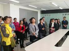 望京街道组织学习八里庄华贸中心社区 促进社区建设提高