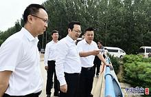 张国华与中国证监会副主席赵争平一行举行座谈